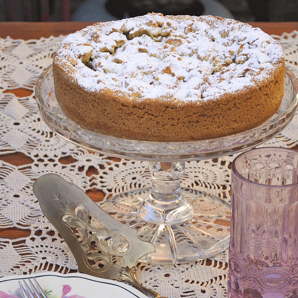 italian apple cake on cake server