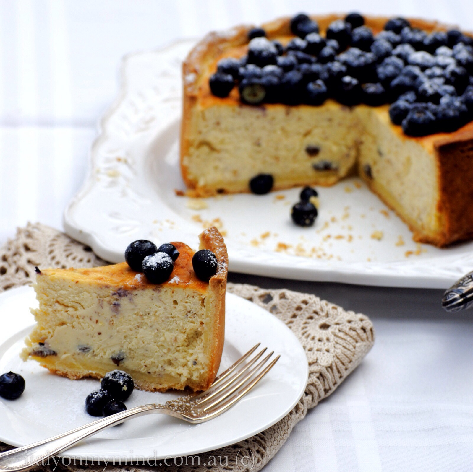 Italian baked ricotta cheesecake with blueberries