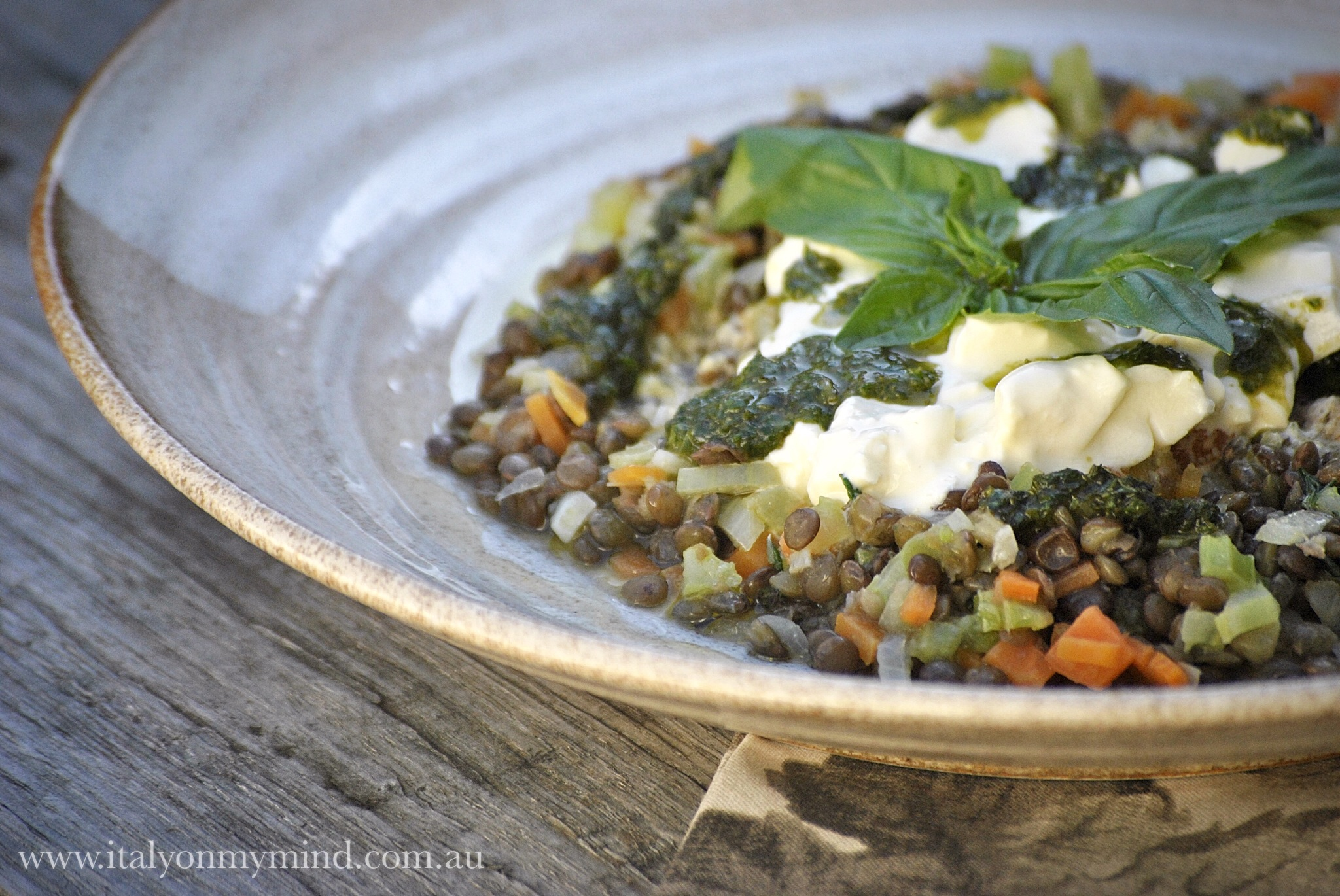 Burrata with lentils and basil oil