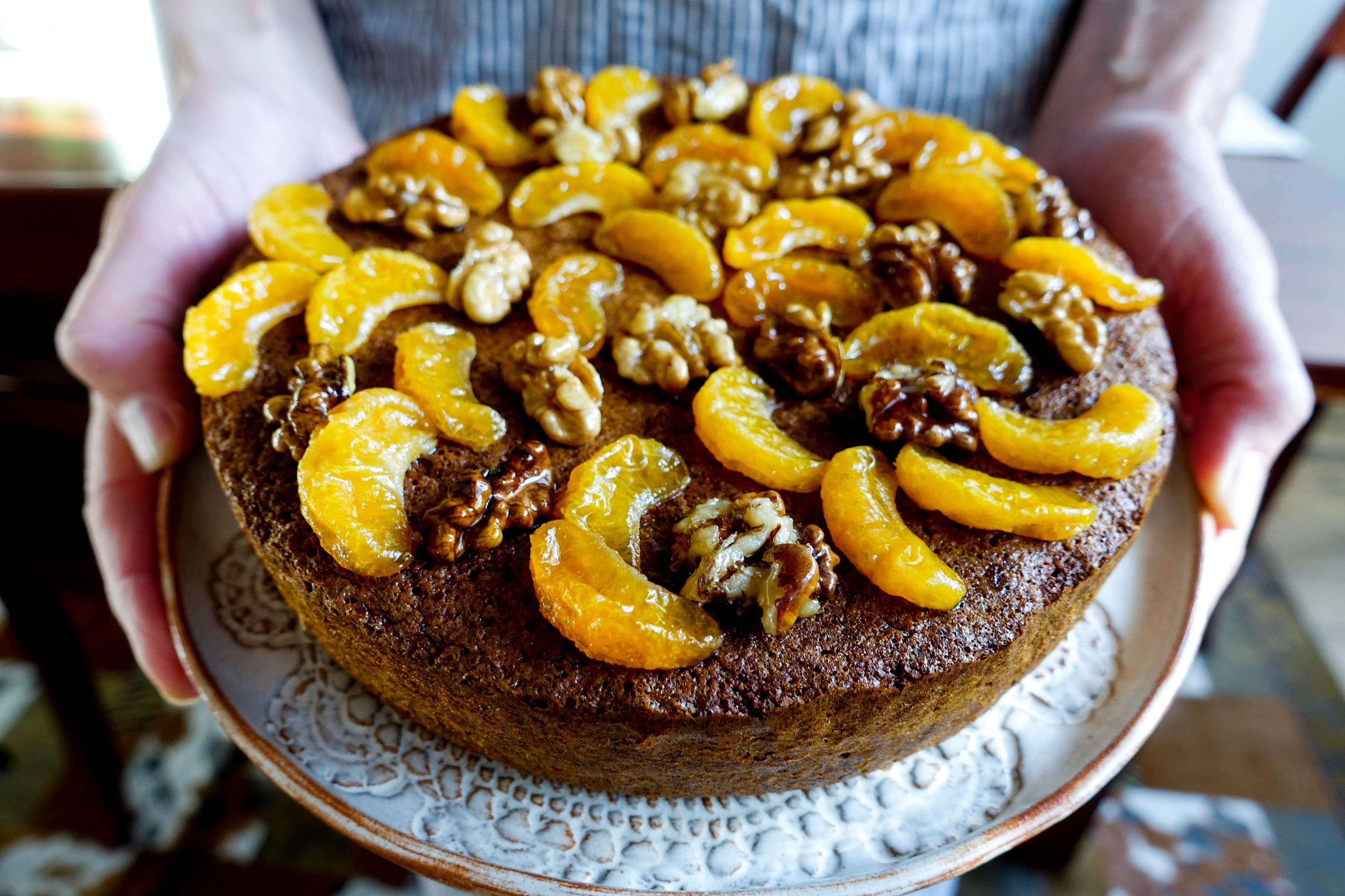 hands on tangerine walnut choc flourless cake-italy on my mind