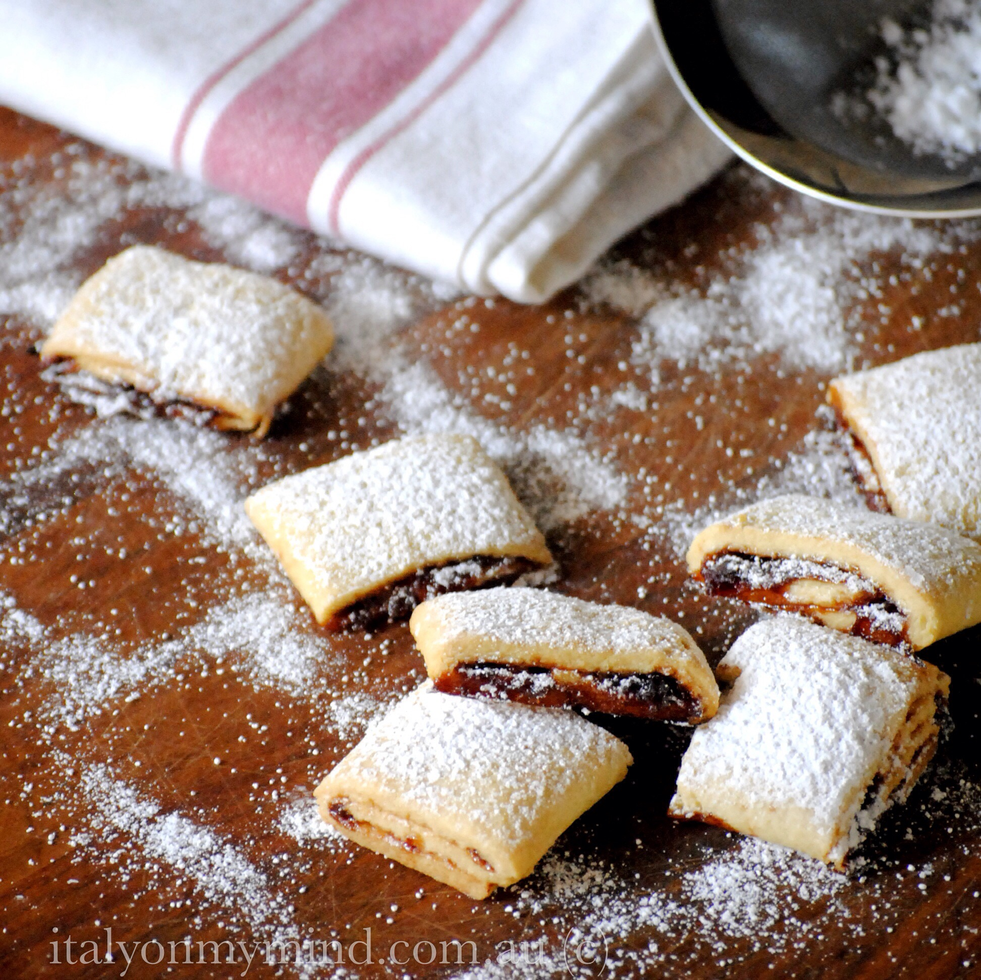 Rolled shortbread biscotti with plum jam