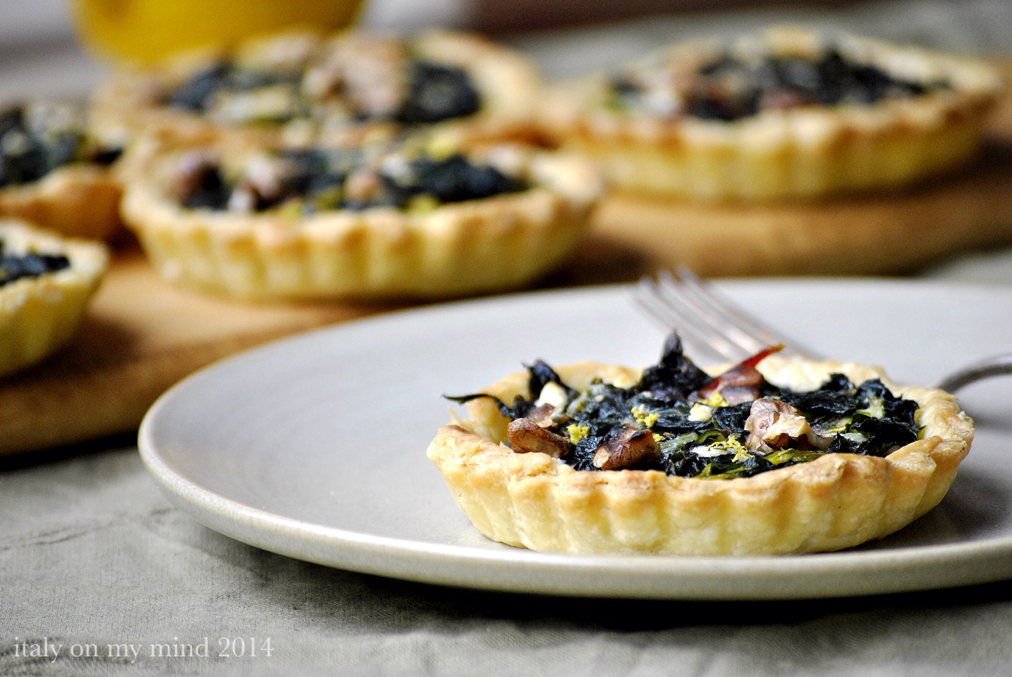 Balsamic onion, silver beet and walnut tartlets