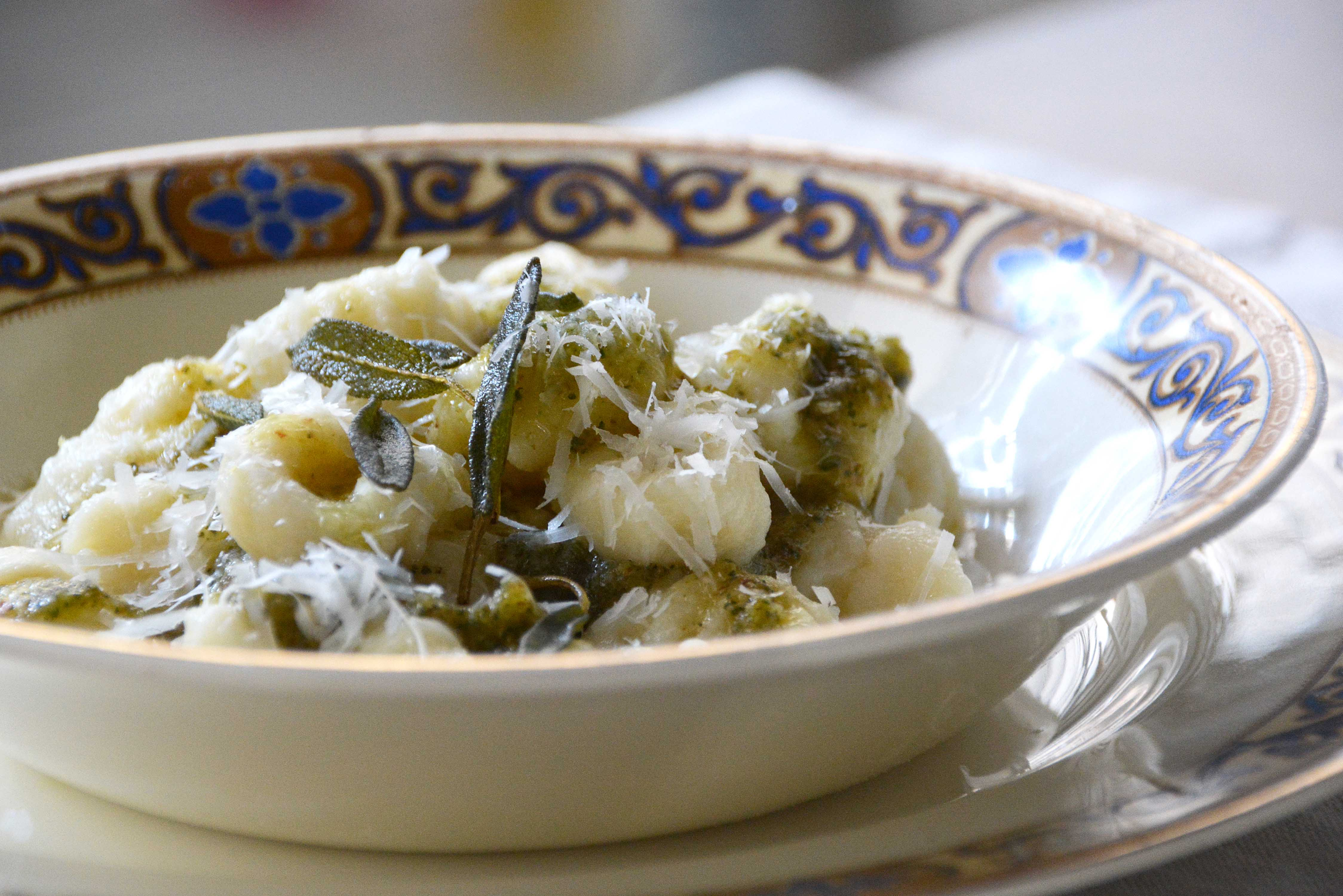 closeup-sage and walnut pesto on gnocchi-italy on my mind